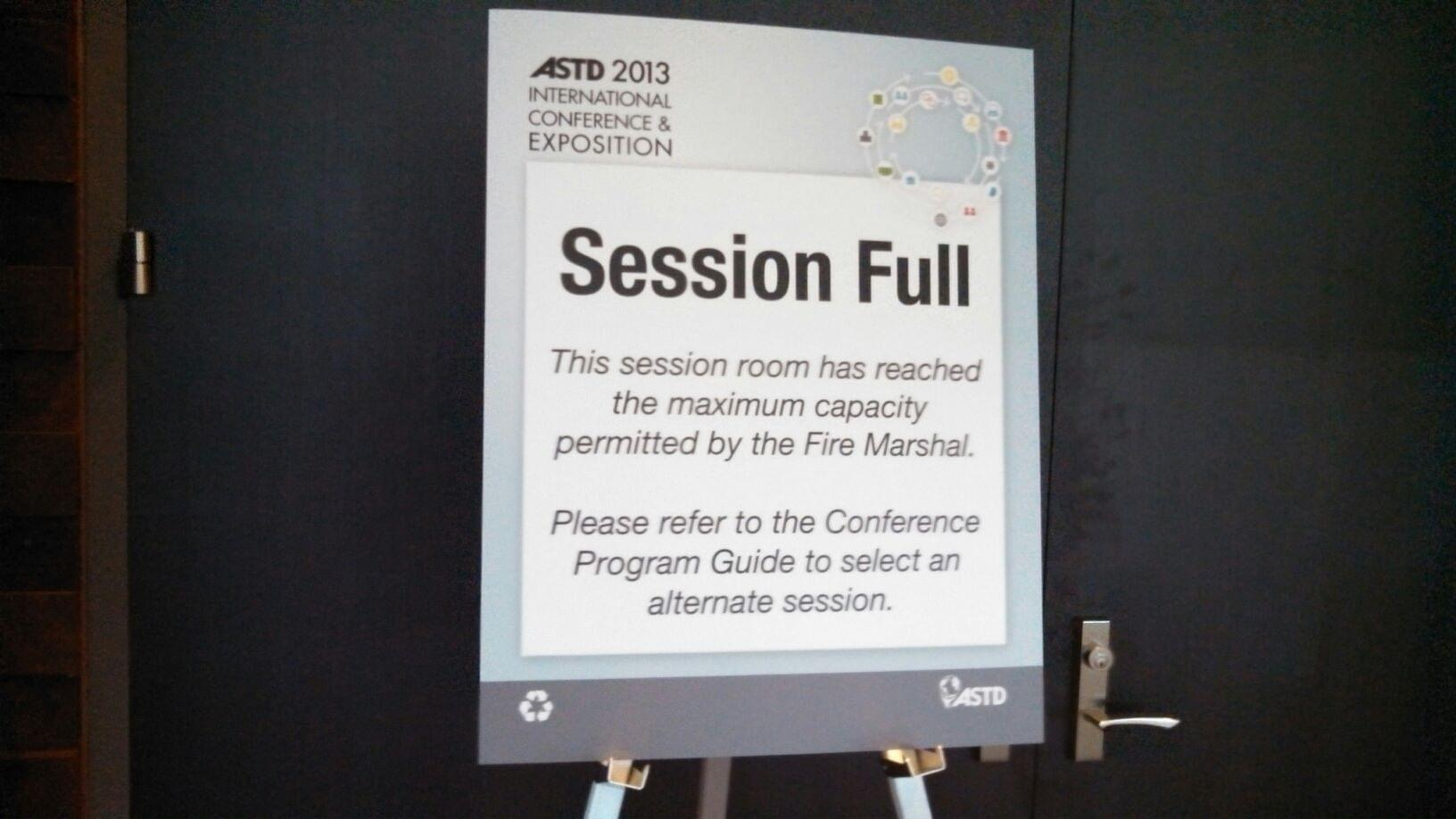 Sign taped to door states that current session is at full capacity